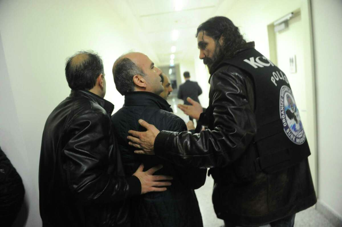 Turkish police officers escort Abdulhamit Bilici (C), editor in chief of Zaman Newspaper out from Newspaper`s headquarters on March 5, 2016 in Istanbul. An Istanbul court on March 4, 2016 ordered into administration a Turkish Zaman daily newspaper that is sharply critical of President Recep Tayyip Erdogan, amid growing alarm over freedom of expression in the country. / AFP / SELAHATTIN SEVISELAHATTIN SEVI/AFP/Getty Images