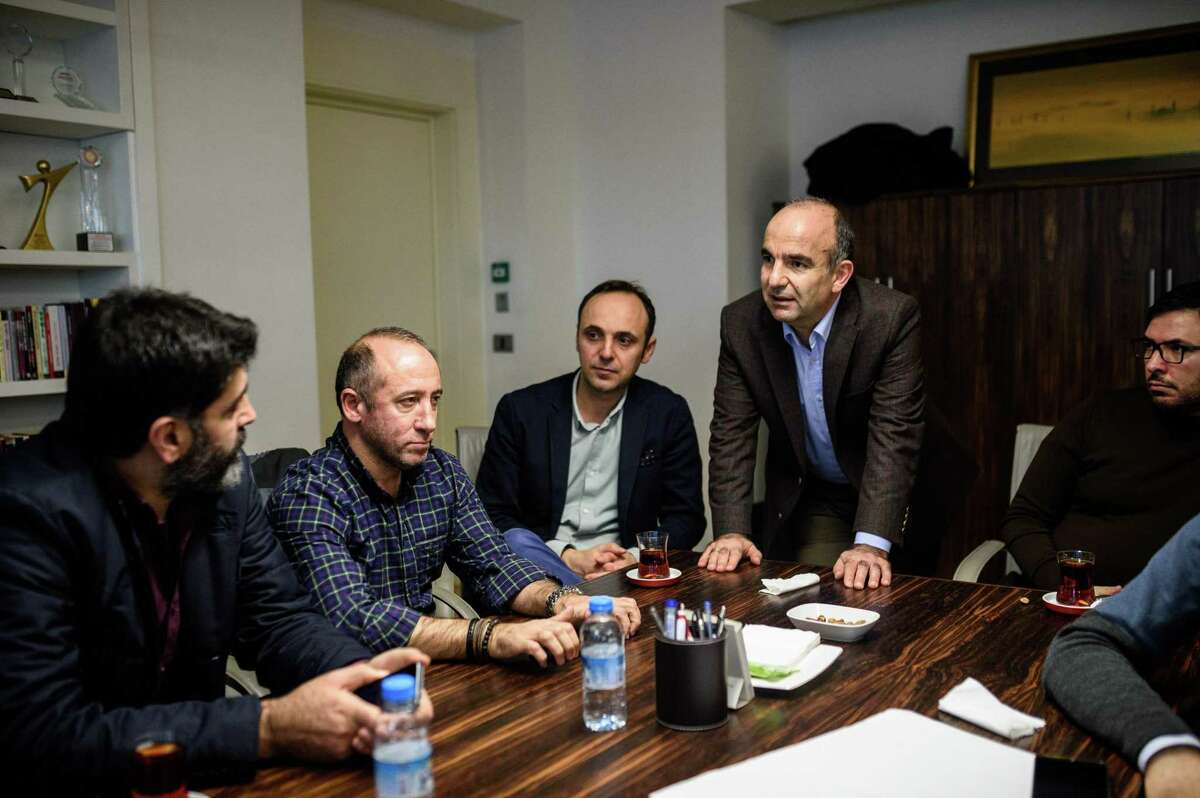 Abdulhamit Bilici (2nd R), editor in chief of Turkish daily newspaper Zaman, talks with his editors and journalists who came in support, at his office at the newspaper's headquarters in Istanbul on March 4, 2016. An Istanbul court on Friday ordered into administration the Turkish daily newspaper Zaman that is sharply critical of President Recep Tayyip Erdogan, amid growing alarm over freedom of expression in the country. / AFP / OZAN KOSEOZAN KOSE/AFP/Getty Images