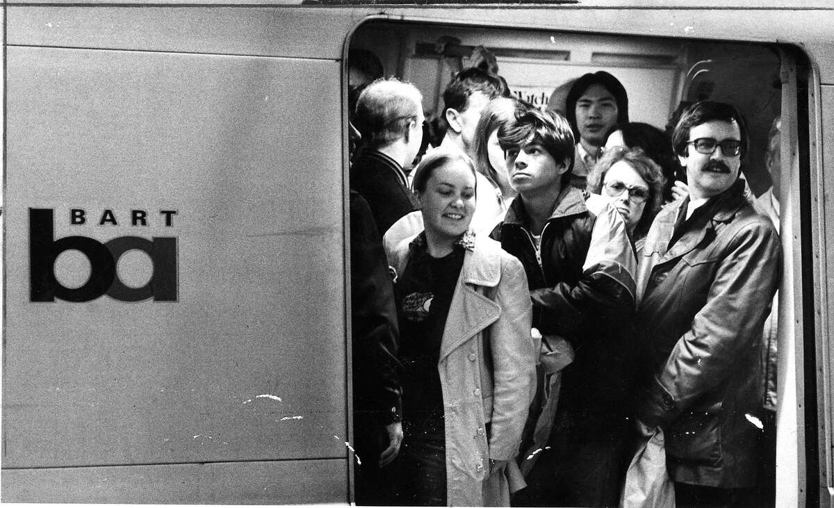 BART riders are crammed in to a car at the Powell Street station Photo ran 06/25/1986, P, 1