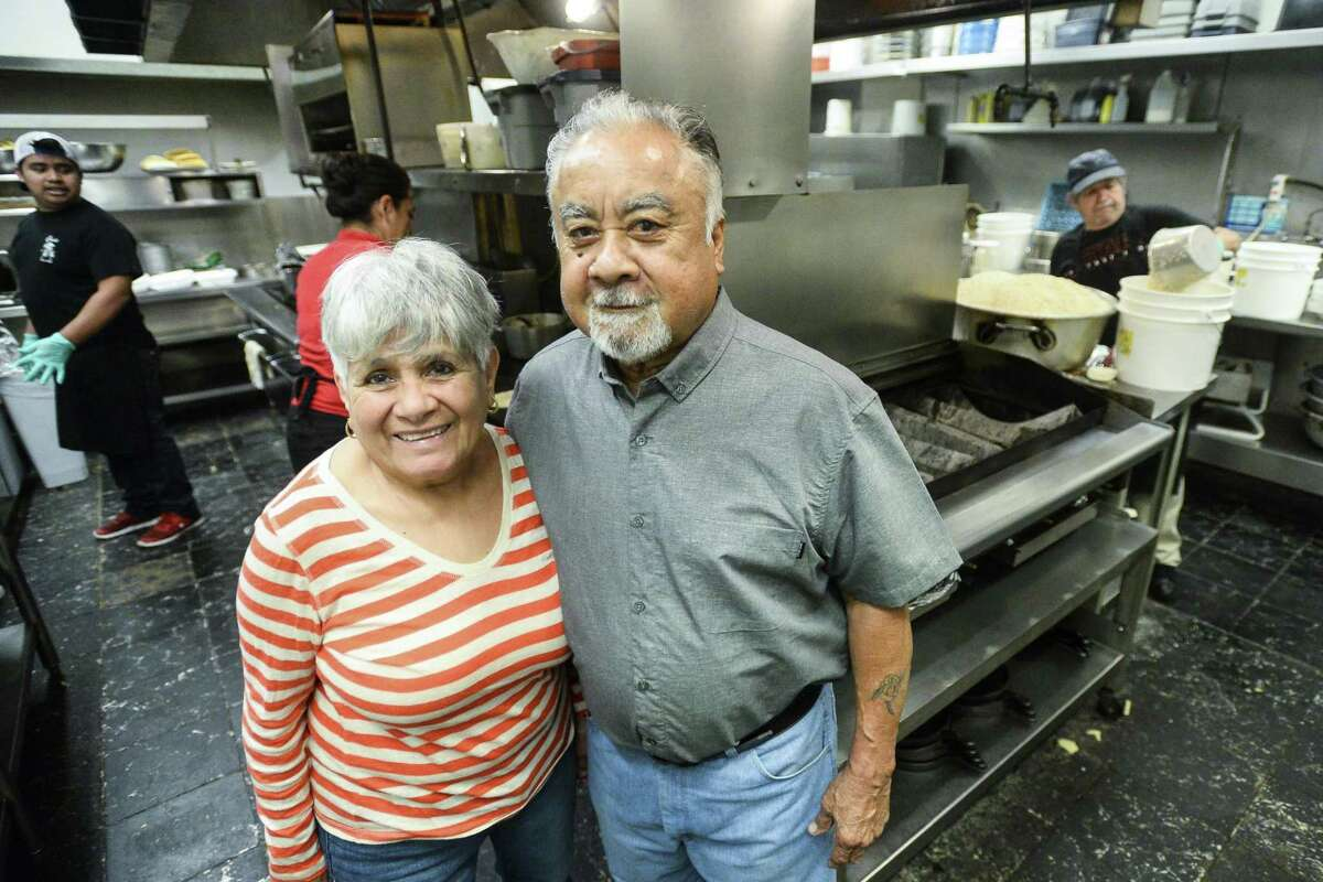 Diana and Ricardo Sr. Sanchez pose for a photo in the kitchen of Elena's Wednesday night. Photo taken on Wednesday, 02/27/19. Ryan Welch/The Enterprise