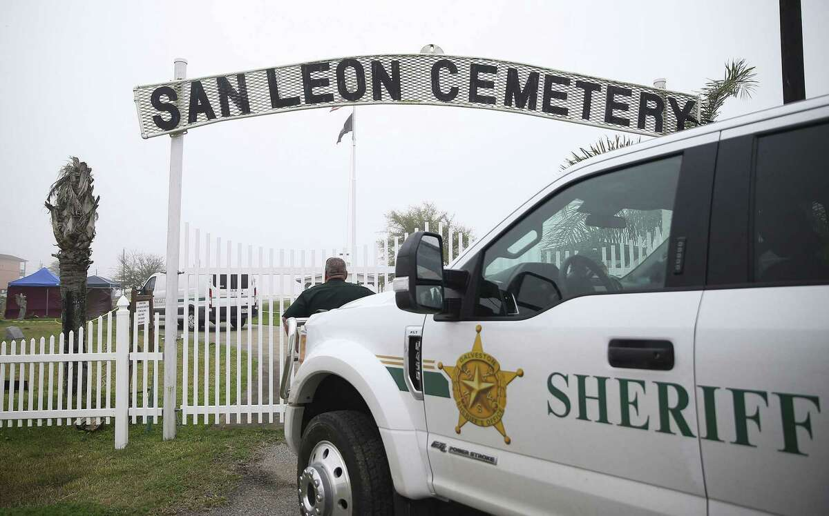 Galveston County Sheriff's Crime Scene Unit excavates an area at the San Leon Cemetery looking for evidence in a cold case on Wednesday, Feb. 27, 2019.