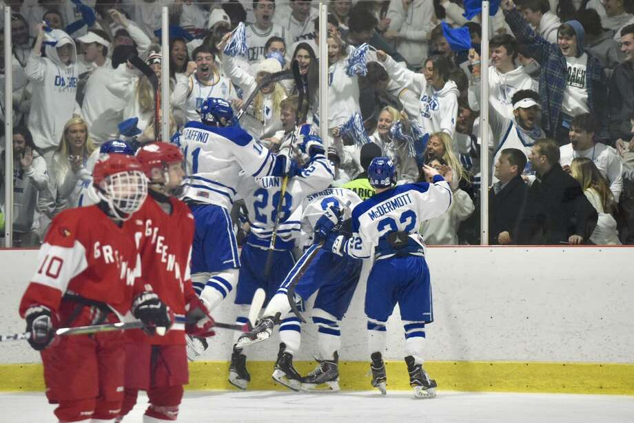 The Darien Blue Wave celebrates in front of their fans after a goal during the second period of the FCIAC boys hockey semifinals at the Darien Ice House on Wednesday, Feb. 27. Photo: Dave Stewart / Hearst Connecticut Media / Hearst Connecticut Media