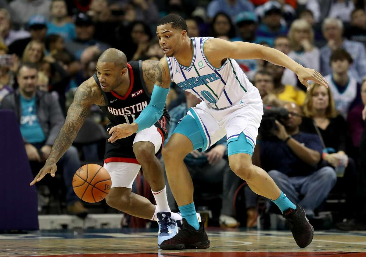CHARLOTTE, NORTH CAROLINA - FEBRUARY 27: PJ Tucker #17 of the Houston Rockets battles for a loose ball against Miles Bridges #0 of the Charlotte Hornets during their game at Spectrum Center on February 27, 2019 in Charlotte, North Carolina. NOTE TO USER: User expressly acknowledges and agrees that, by downloading and or using this photograph, User is consenting to the terms and conditions of the Getty Images License Agreement. (Photo by Streeter Lecka/Getty Images)