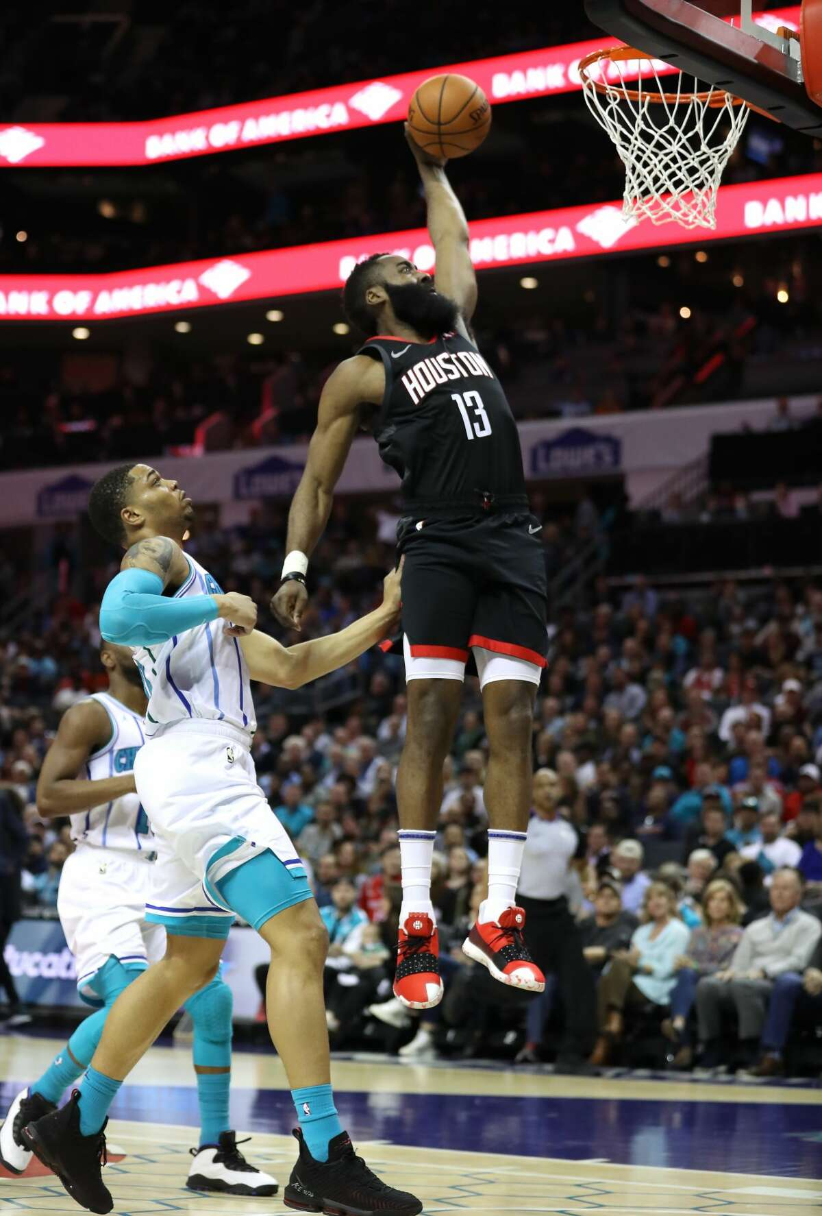 CHARLOTTE, NORTH CAROLINA - FEBRUARY 27: Miles Bridges #0 of the Charlotte Hornets watches as James Harden #13 of the Houston Rockets dunks the ball during their game at Spectrum Center on February 27, 2019 in Charlotte, North Carolina. NOTE TO USER: User expressly acknowledges and agrees that, by downloading and or using this photograph, User is consenting to the terms and conditions of the Getty Images License Agreement. (Photo by Streeter Lecka/Getty Images)