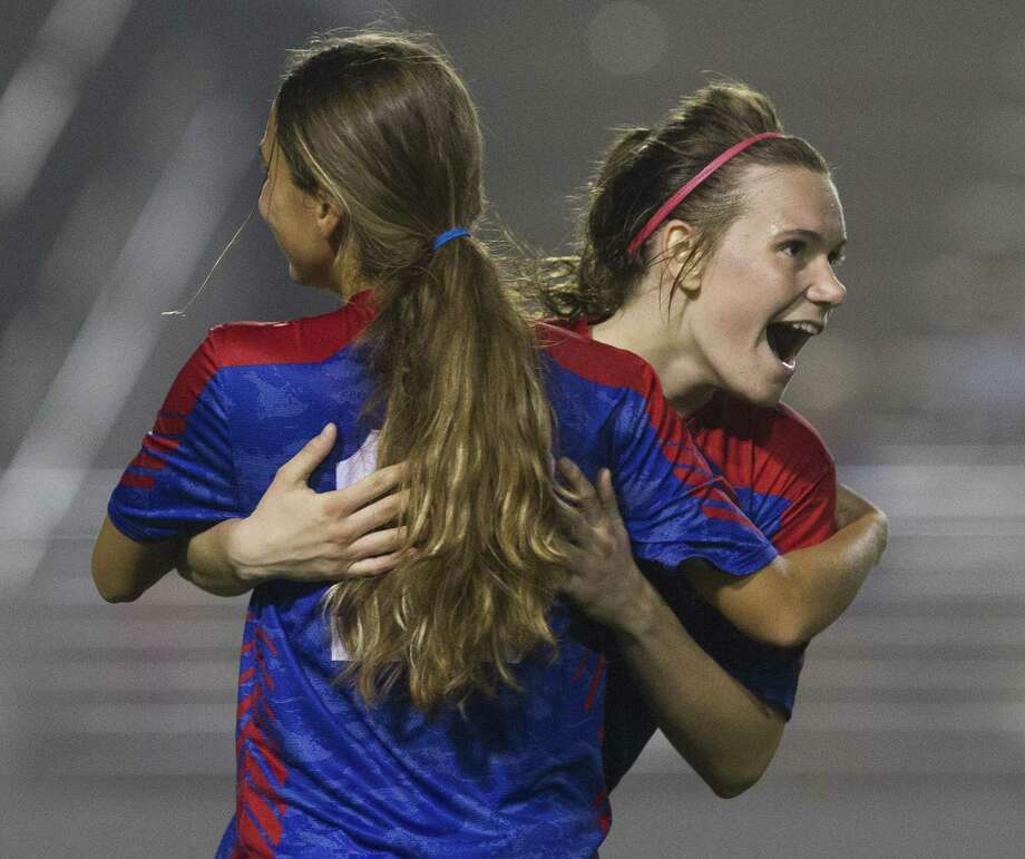 Oak Ridge Melissa Landon, left, reacts with Brianna Roberts after her goal during the second period of a District 15-6A high school soccer match at Woodforest Bank Stadium, Wednesday, Feb. 27, 2019, in Shenandoah. Photo: Jason Fochtman, Houston Chronicle / Staff Photographer / © 2019 Houston Chronicle