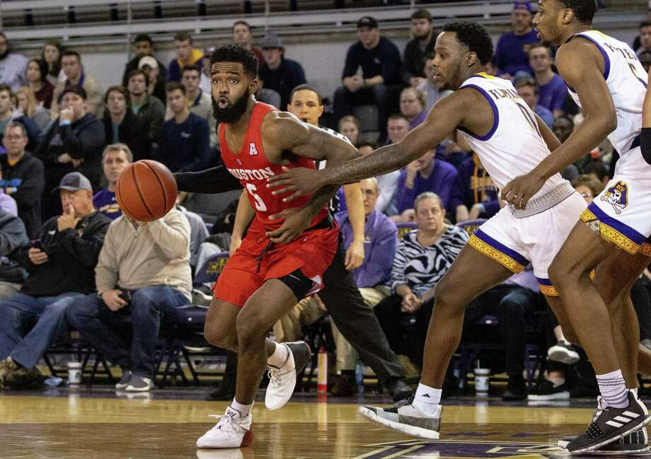 Houston's Corey Davis Jr. (5) dribbles around East Carolina's Isaac Fleming (0) during the second half of an NCAA college basketball game in Greenville, N.C., Wednesday, Feb. 27, 2019. (AP Photo/Ben McKeown) Photo: Ben McKeown, FRE / Associated Press / Copyright 2019 The Associated Press. All rights reserved