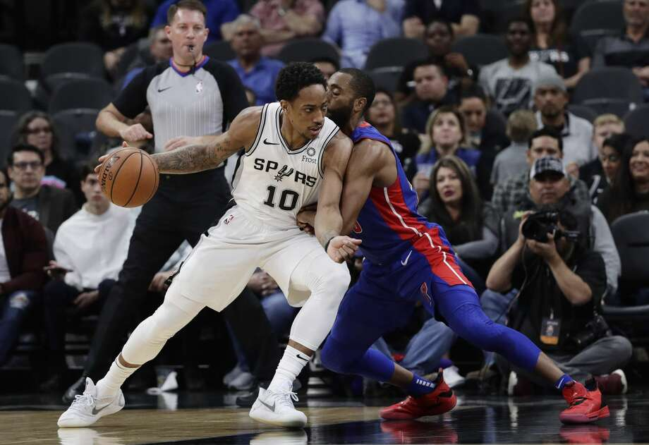 San Antonio Spurs guard DeMar DeRozan (10) is defended by Detroit Pistons guard Wayne Ellington during the first half of an NBA basketball game in San Antonio, Wednesday, Feb. 27, 2019. (AP Photo/Eric Gay) Photo: Eric Gay/Associated Press
