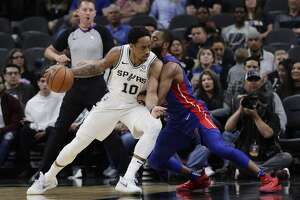 San Antonio Spurs guard DeMar DeRozan (10) is defended by Detroit Pistons guard Wayne Ellington during the first half of an NBA basketball game in San Antonio, Wednesday, Feb. 27, 2019. (AP Photo/Eric Gay)
