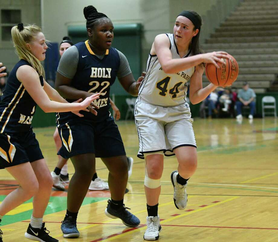 f410445bd31 Averill Park's Olivia Kelley looks to pass during a Class A basketball  semifinal game against Holy