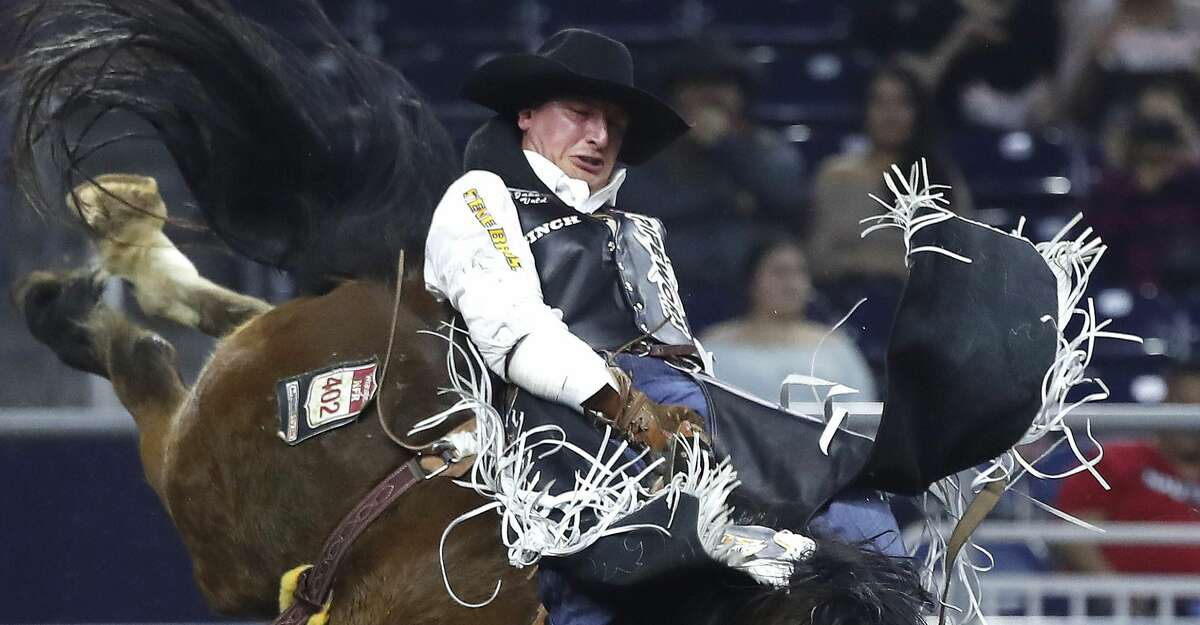 Jake Vold rides Sun Glow as he competed in the bareback riding competition during round 2 of Super Series I of the Houston Livestock Show and Rodeo at NRG Stadium, Tuesday, Feb. 26, 2019, in Houston.