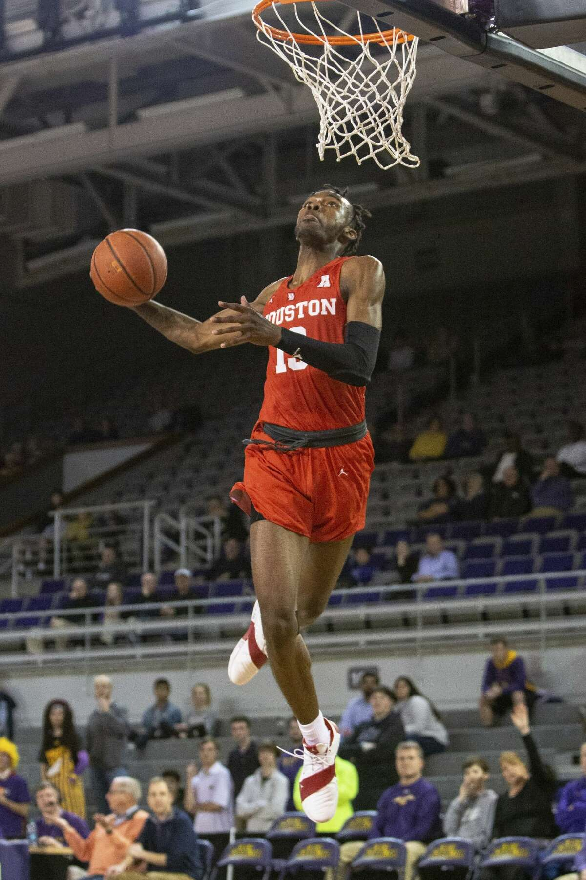 Houston's DeJon Jarreau (13) jumps for a dunk during the second half of an NCAA college basketball game against East Carolina in Greenville, N.C., Wednesday, Feb. 27, 2019. (AP Photo/Ben McKeown)