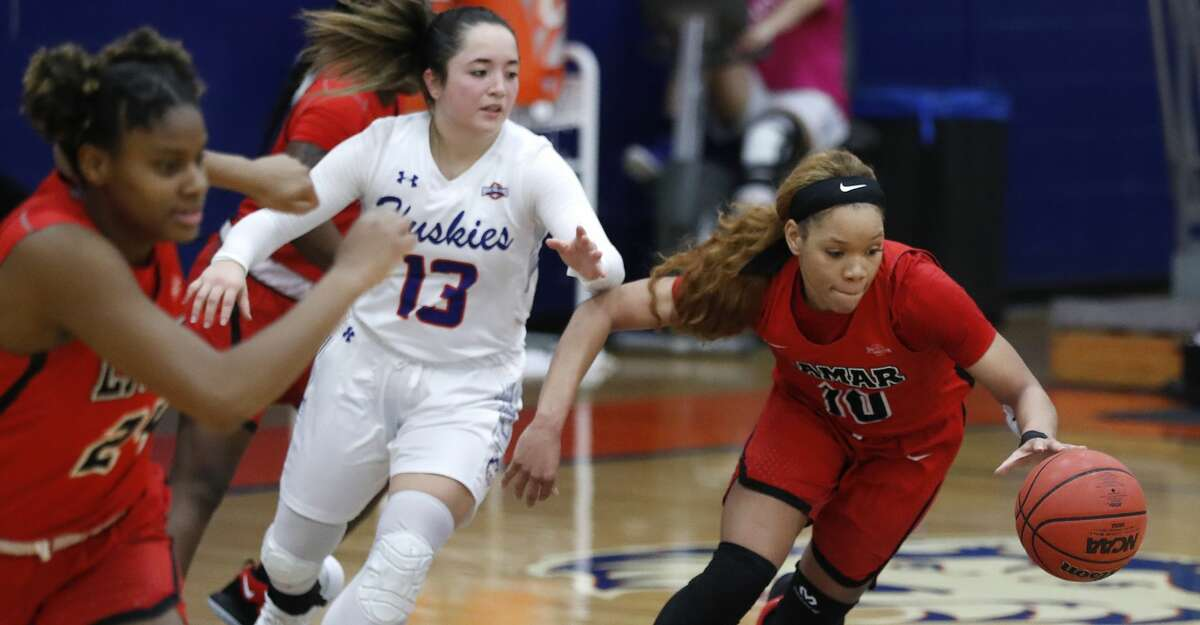 Lamar's Chastadie Barrs (10) steals the ball from HBU's Megan Valdez-Crader (13) during the second half of a women's NCAA basketball game at Sharp Gymnasium on the campus of Houston Baptist University, Wednesday, Feb. 27, 2019, in Houston.