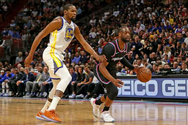 9a92897debf0 Dwyane Wade s buzzer-beating 3 leaves Warriors stunned - SFChronicle.com