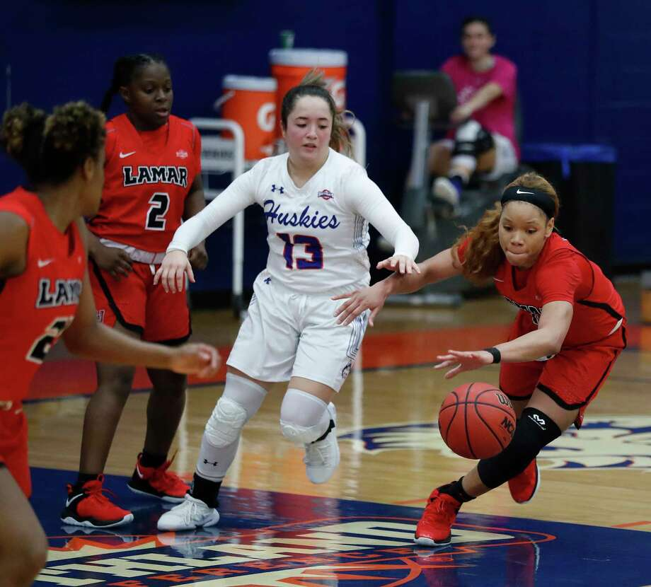 Lamar's Chastadie Barrs (10) steals the ball from HBU's Megan Valdez-Crader (13) during the second half of a women's NCAA basketball game at Sharp Gymnasium on the campus of Houston Baptist University, Wednesday, Feb. 27, 2019, in Houston. Photo: Karen Warren, Staff Photographer / © 2019 Houston Chronicle