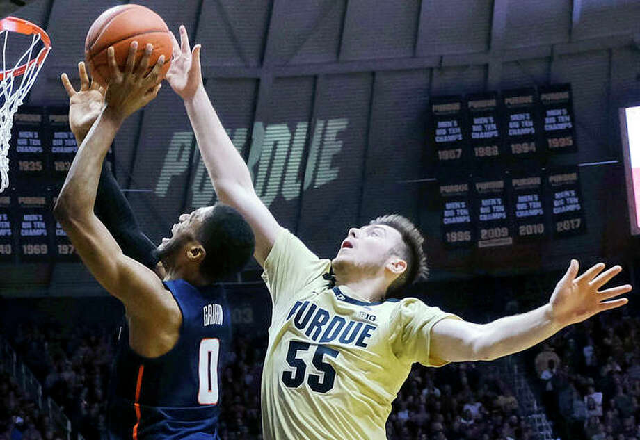 Purdue's Sasha Stefanovic (55) fouls Illinois guard Alan Griffin during Wednesday night's Big Ten Conference game in West Lafayette, Ind. Photo: AP Photo