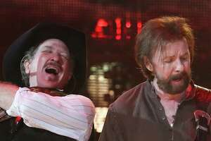 Kix Brook (left) and Ronnie Dunn of Brooks and Dunn perform at the Houston Livestock Show and Rodeo Wednesday, Feb. 27, 2019, in Houston.