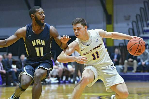 University at Albany's Cameron Healy drives to the net against New Hampshire's Jordan Reed during a basketball game at SEFCU Arena on Wednesday, Feb. 27, 2019 in Albany, N.Y. (Lori Van Buren/Times Union)
