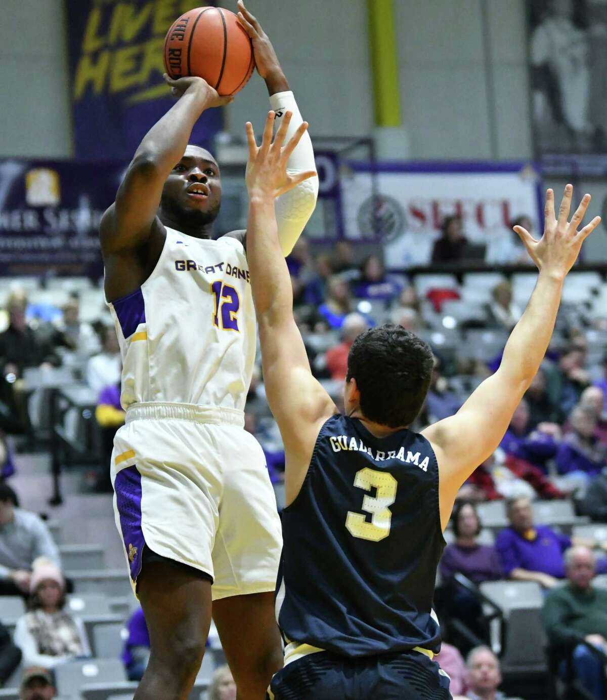 University at Albany's Devonte Campbell goes up for a shot against New Hampshire's Rayshawn Miller during a basketball game at SEFCU Arena on Wednesday, Feb. 27, 2019 in Albany, N.Y. (Lori Van Buren/Times Union)