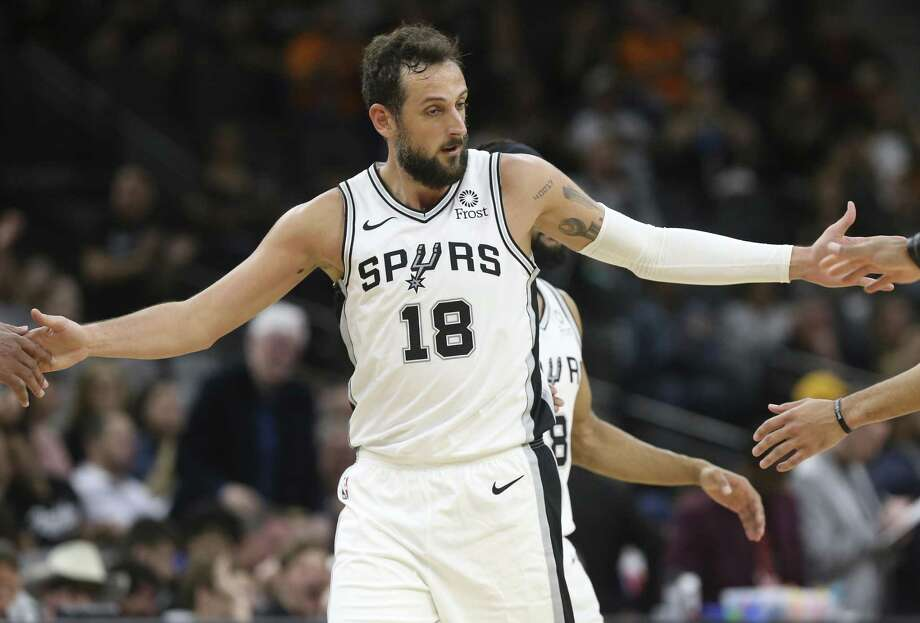 San Antonio Spurs' Marco Belinelli slaps hand with teammates after scoring a three-pointer during the second half against the Detroit Pistons at the AT&T Center, Wednesday, Feb. 27, 2019. The Spurs won, 105-93. Photo: Jerry Lara / Staff Photographer / © 2019 San Antonio Express-News