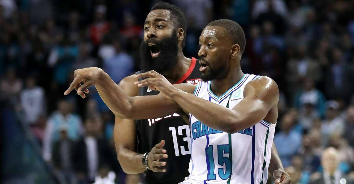 CHARLOTTE, NORTH CAROLINA - FEBRUARY 27: James Harden #13 of the Houston Rockets reacts against Kemba Walker #15 of the Charlotte Hornets during their game at Spectrum Center on February 27, 2019 in Charlotte, North Carolina. NOTE TO USER: User expressly acknowledges and agrees that, by downloading and or using this photograph, User is consenting to the terms and conditions of the Getty Images License Agreement. (Photo by Streeter Lecka/Getty Images)