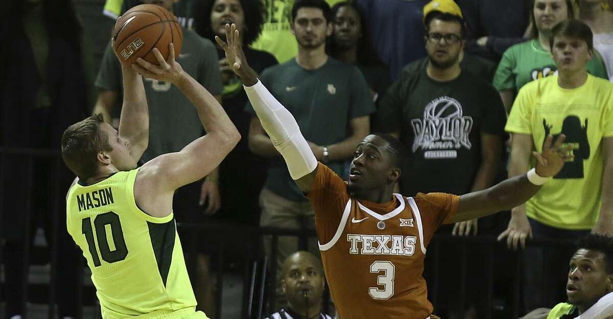 Baylor guard Makai Mason (10) shoots as Texas guard Courtney Ramey defends during the first half of a NCAA college basketball game Wednesday, Feb. 27, 2019, in Waco, Texas. (Jerry Larson/Waco Tribune Herald via AP)