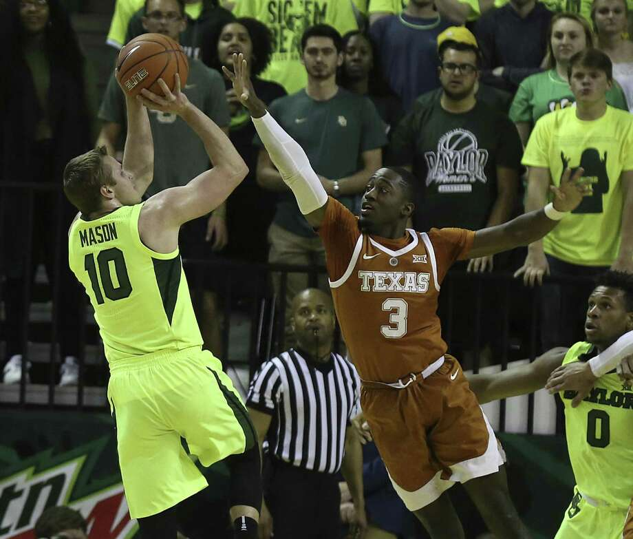 Baylor guard Makai Mason shoots as Texas guard Courtney Ramey defends in the first half of the Bears' comeback win. Photo: Jerry Larson / Associated Press / Waco Tribune Herald