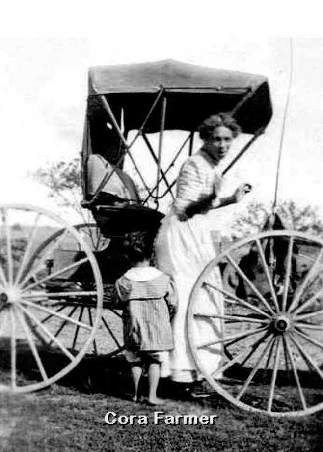 Cora Farmer in her buggy.