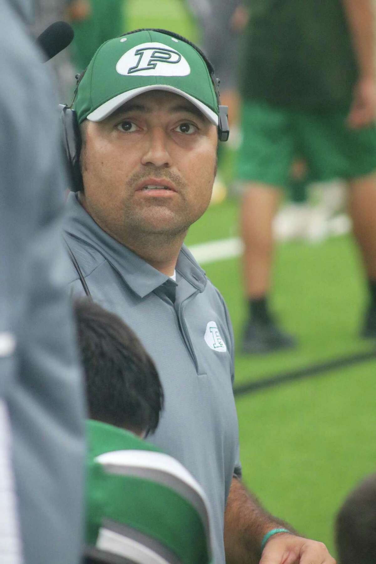 David Zapien, preparing to huddle with Pasadena's offensive players this past season, has formally been named as the program's new head football coach, following approval by the school board Tuesday night. Pasadena's homegrown kid becomes just the fourth head coach in the last 29 years.