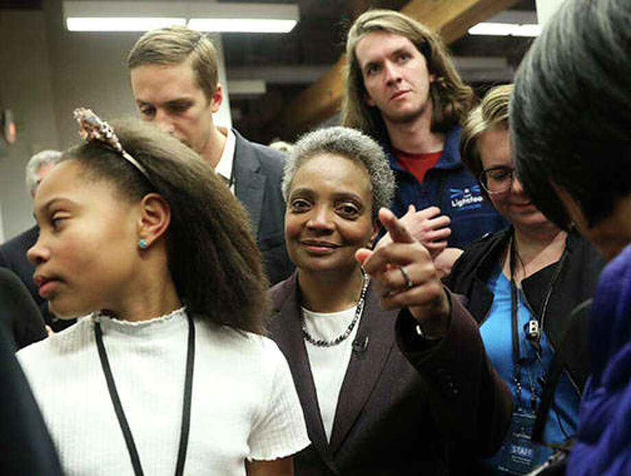 Mayoral candidate Lori Lightfoot and her daughter, Vivian, appear with supporters at EvolveHer in Chicago. Former federal prosecutor Lightfoot, who could become the first African-American woman to lead the nation's third-largest city, was the top vote-getter in a field of 14 that included a member of the Daley family that has dominated Chicago politics for much of the last six decades. Photo: Erin Hooley | Chicago Tribune (AP)