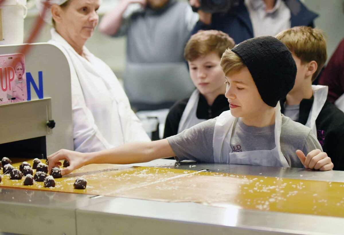 Cast member of Proctor's Charlie and the Chocolate Factory, Henry Boshart, 10, tries a coconut egg during a tour of KrauseOs Homemade Candy on Wednesday, Feb. 27, 2019 at KrauseOs Homemade Candy in Albany, NY. (Phoebe Sheehan/Times Union)