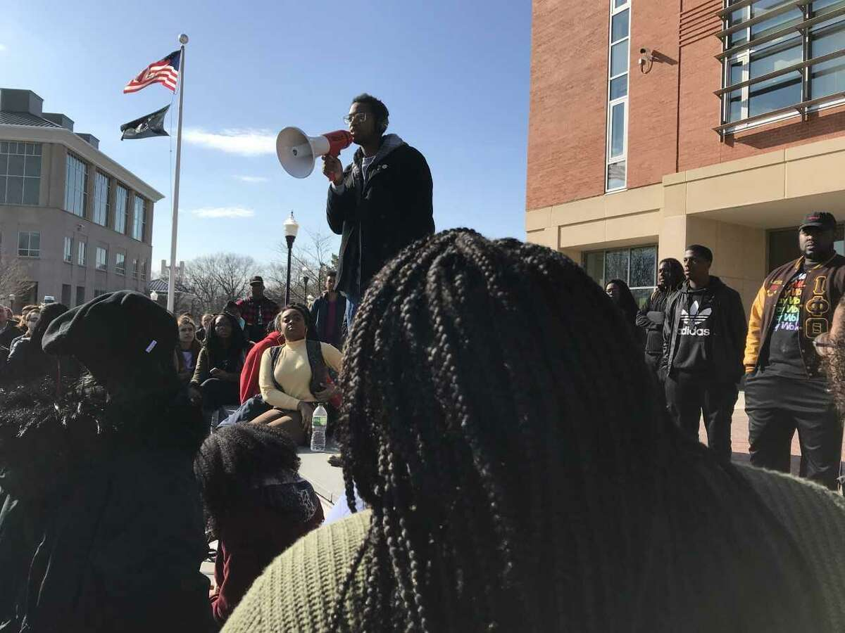 Justin Farmer, a Hamden city councilman and a student at Southern Connecticut State University, addresses a rally a week after a white faculty member used a racial slur.