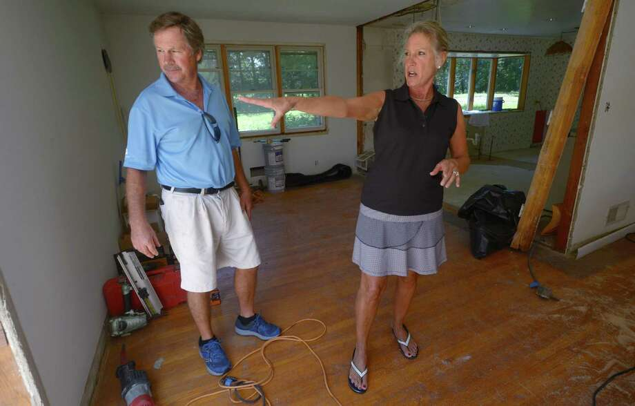 House flippers Jay and Leslie Vincent in July 2018 at a project site in Norwalk, Conn. Photo: Erik Trautmann / Hearst Connecticut Media / Norwalk Hour