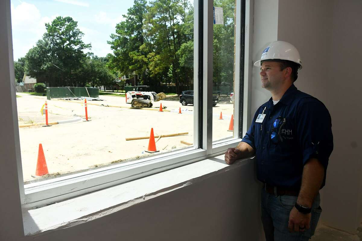 Lemm Elementary Assistant Principal Adam Tietze looks out the window of his office on July 11, 2018, which is part of the new interior in the school building after flooding from Hurricane Harvey. (Jerry Baker/For the Chronicle)