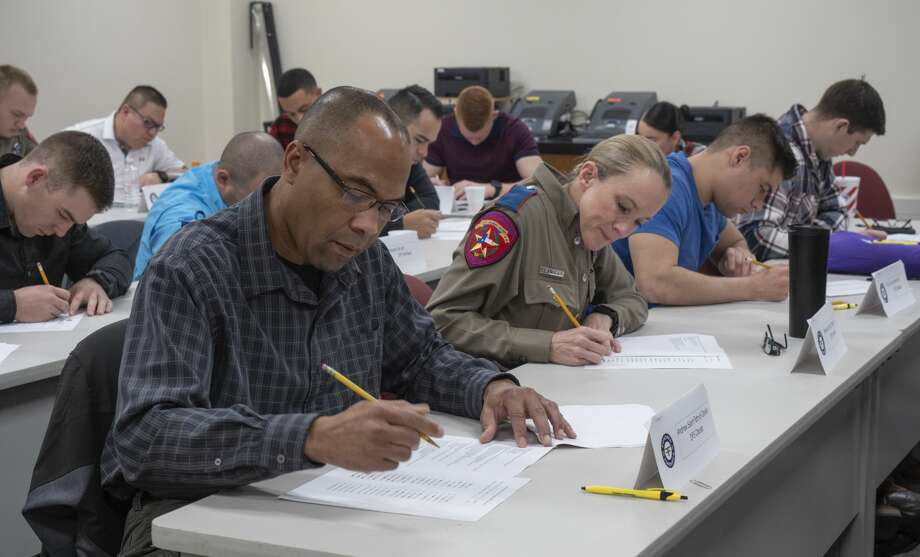 Area law enforcement complete a test on Feb. 28 during a three-day workshop for the Texas Breath Alcohol Testing Program as part of workforce training classes offered at the Midland College Advanced Technology Center. Photo: Tim Fischer