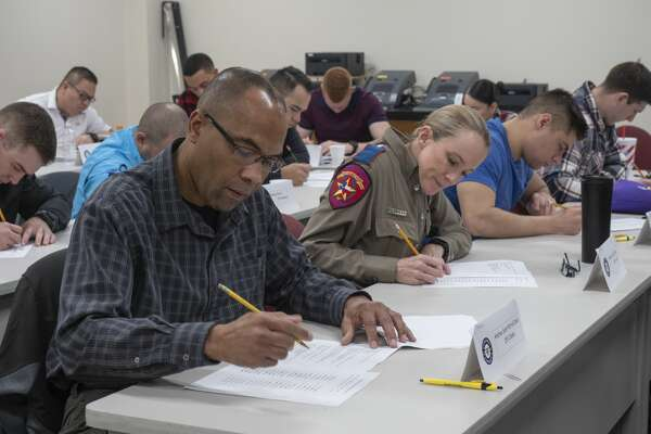 Area law enforcement and Texas State Troopers complete a test 02/28/2019 during a three day workshop on Texas Breath Alcohol Testing Program as part of workforce training classes offered at the Midland College Advanced Technology Center. Tim Fischer/Reporter-Telegram