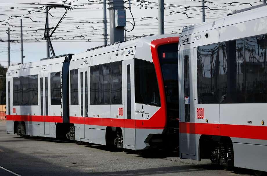New MUNI trains sit on tracks at MUNI Metro East Maintenance Facility July 20, 2017 in San Francisco, Calif. Photo: Leah Millis / The Chronicle