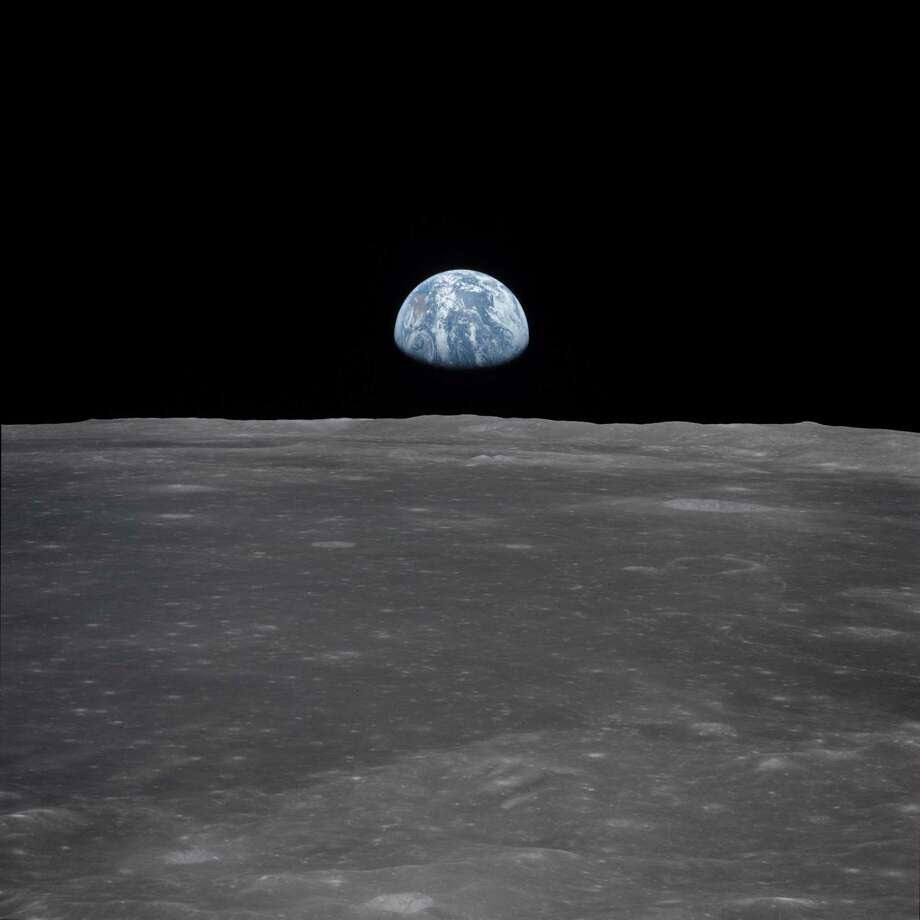 View of Moon limb with Earth on the horizon,Mare Smythii Region. Earth rise. This image was taken before separation of the LM and the Command Module during Apollo 11 Mission. Original film magazine was labeled V. Film Type: S0-368 Color taken with a 250mm lens. Approximate photo scale 1:1,300,000. Principal Point Latitude was 3 North by Longitude 85 East. Foward overlap is 90%. Sun angle is High. Approximate Tilt minimum is 65 degrees,maximum is 69. Tilt direction is West (W). Photo: NASA / Courtesy