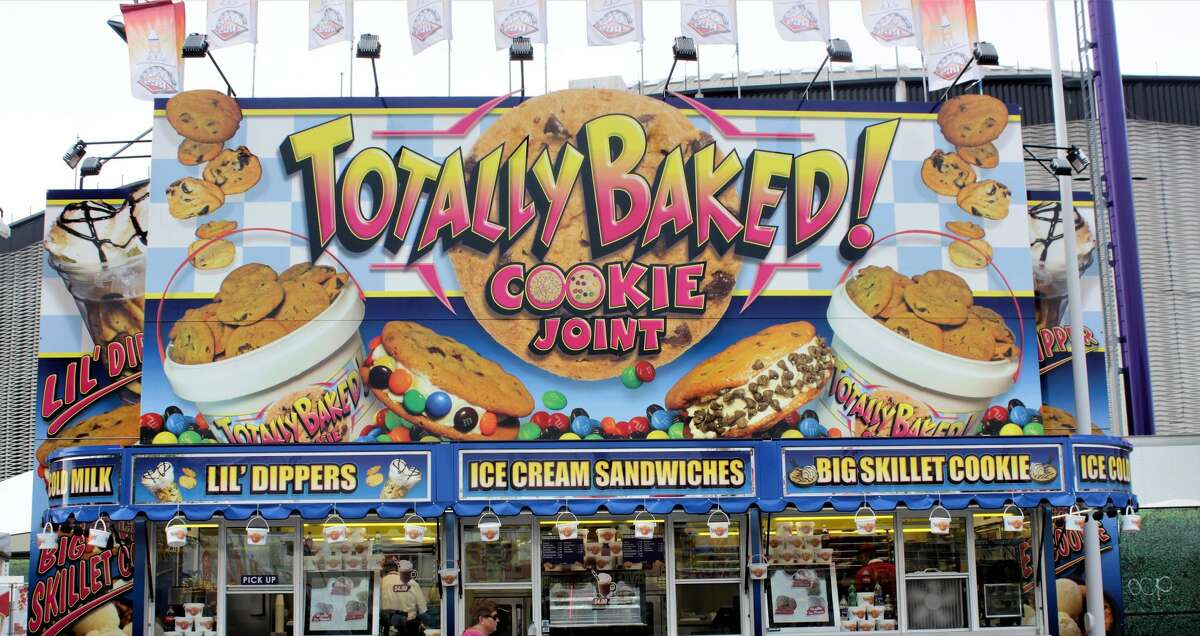 Load up on treats at the Totally Baked Cookie Joint. >>> Click through to see more bizarre signage at the Rodeo Houston carnival.