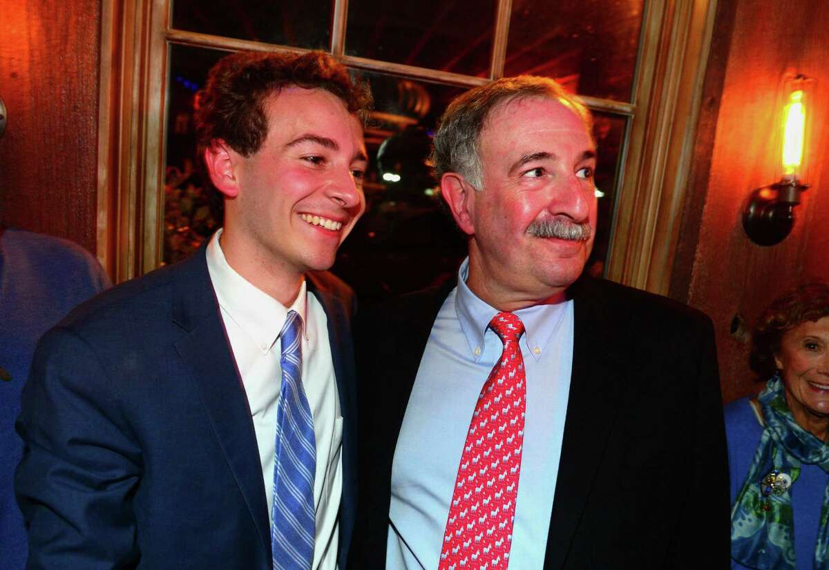 Democrat Will Haskell, running for State Senate, left, stands with State Rep Jonathan Steinberg during a post election party at the Little Barn in Westport, Conn., on Tuesday Nov. 6, 2018.