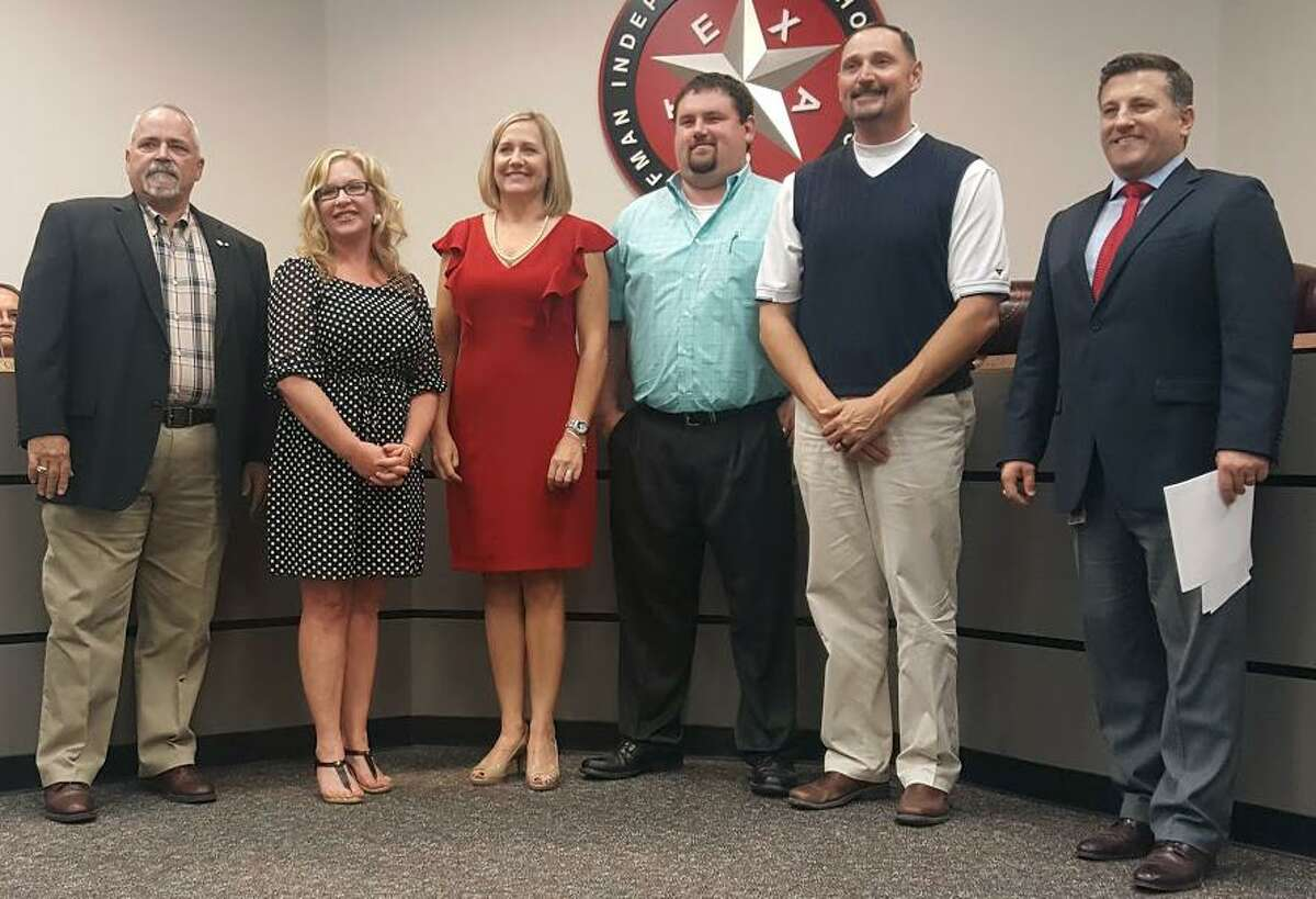The principals of Huffman ISD's schools are commended for their efforts throughout hurricane Harvey during the school board meeting on Monday, Sept. 25. From left to right: school board member Ray Burt, Ben Bowen principal Melissa Hutchinson, Copeland Elementary principal Amy Turner, Huffman Middle School principal Adam Skinner, Hargrave High School principal Brandon Perry, superintendent Benny Soileau.