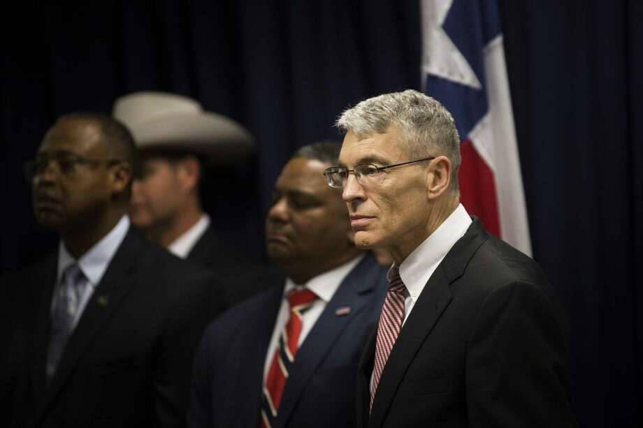 Steve McCraw, right, director of the Texas Department of Public Safety and FBI's Houston Division special agent in charge Perrye K. Turner, joined Texas Governor Greg Abbott, left, to announce a new plan against gang violence, Monday, April 10, 2017, in Houston. ( Marie D. De Jesus / Houston Chronicle ) Photo: Marie D. De Jesus, Staff / Houston Chronicle / © 2017 Houston Chronicle