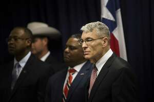 Steve McCraw, right, director of the Texas Department of Public Safety and FBI's Houston Division special agent in charge Perrye K. Turner, joined Texas Governor Greg Abbott, left, to announce a new plan against gang violence, Monday, April 10, 2017, in Houston. ( Marie D. De Jesus / Houston Chronicle )