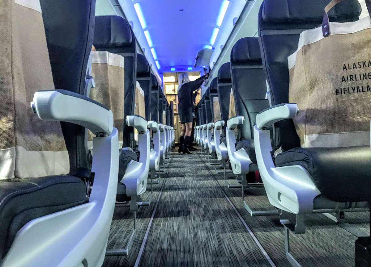 New carpeting, seats and blue mood lighting and more on Alaska Airlines Airbus A321- a big change from the Virgin America configuration