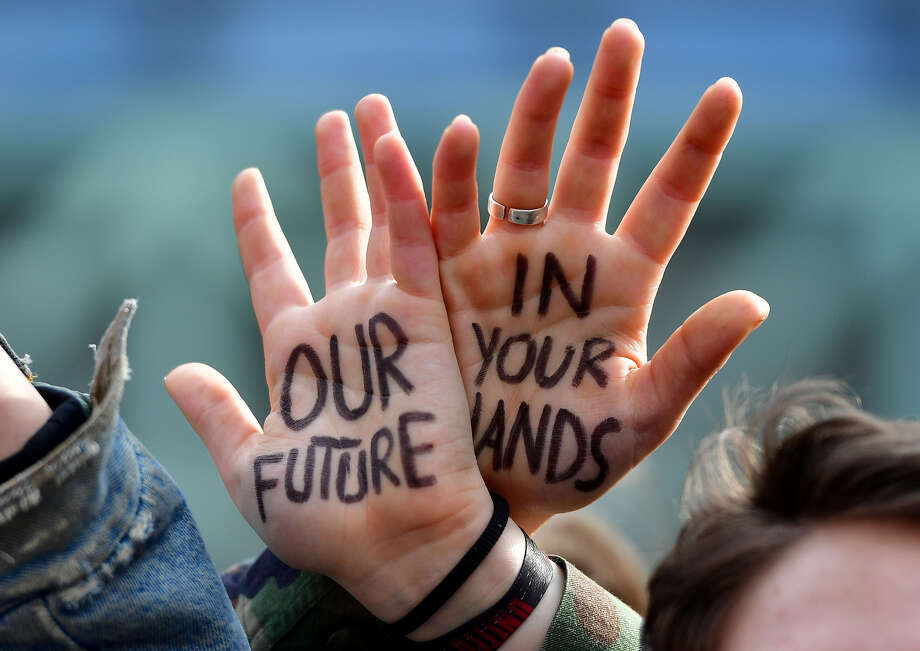 Students take part in a march for the environment and the climate o, in Brussels, on February 21, 2019. - Greta Thunberg, the 16-year-old Swedish climate activist who has inspired pupils worldwide to boycott classes, urged the European Union on February 21, 2019 to double its ambition for greenhouse gas cuts. (Photo by EMMANUEL DUNAND / AFP) (Photo credit should read EMMANUEL DUNAND/AFP/Getty Images) Photo: Emmanuel Dunand / AFP / Getty Images