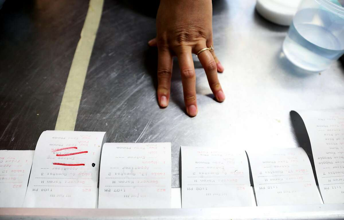 Nite Yun, chef and owner of Cambodian restaurant Nyum Bai, looks at food orders in Oakland, Calif., on Friday, February 15, 2019. Her restaurant is located at 3340 E. 12th St.