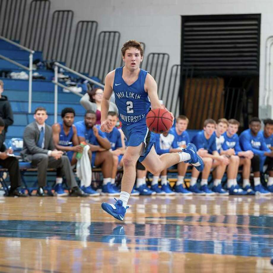 Millilkin University freshman Jack Marinko, a 2018 Edwardsville graduate, brings up the ball up the court during a game this season. Photo: Millikin University Athletics