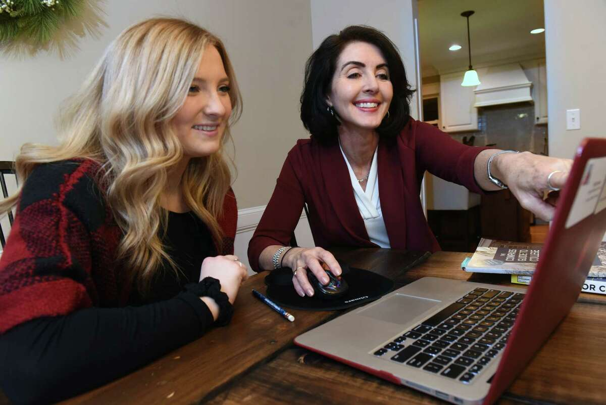 Kelly Linehan, founder of Linehan College Counseling, right, works with student Megan Delehanty in Megan's home on Tuesday, Jan. 22, 2019 in Niskayuna, N.Y. Kelly's business focuses on helping students navigating the college application process. (Lori Van Buren/Times Union)