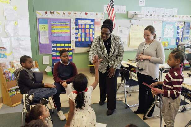 Albany schools superintendent Kaweeda Adams gives a high five to a third grade student in Erin Heid's class at Arbor Hill Elementary School on Wednesday, Jan. 23, 2019, in Albany, N.Y. (Paul Buckowski/Times Union)