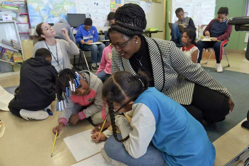 Albany schools superintendent Kaweeda Adams works with some third grade students in Erin Heid's class at Arbor Hill Elementary School on Wednesday, Jan. 23, 2019, in Albany, N.Y. (Paul Buckowski/Times Union)