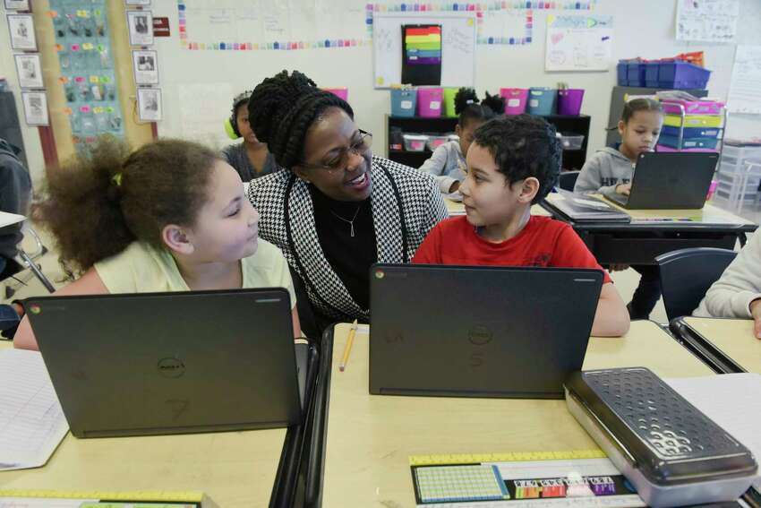 Albany schools superintendent Kaweeda Adams talks with students at Arbor Hill Elementary School on Wednesday, Jan. 23, 2019, in Albany, N.Y. (Paul Buckowski/Times Union)